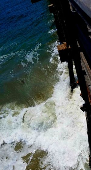 Sommergefühle Power Freshness Powerful Dramatic Waves Crashing Wave Peaceful Dramatic Determination Strength Waves Freedom Pier Meditation Shadow Copyspace Lets Go. Together. Background Theraputic Blue Sunlight Ocean Water Outdoors Enjoying Life