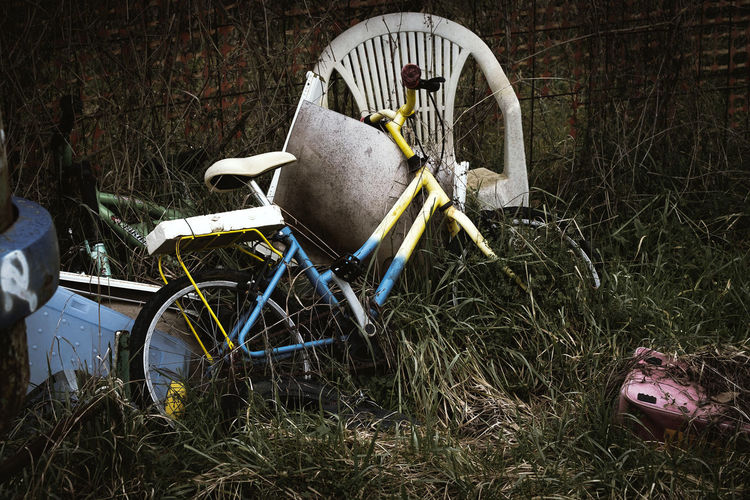 Abandoned & Derelict Abandoned Places Chair Global Warming Pollution In My World Vintage Style Abandoned Bike Childhood Childhood Memories Damaged Day Dump Garbage Grass Landfill No People Outdoors Plastic Pollen Pollution Recycle Recycling Urban Vintage