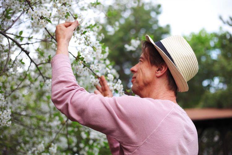 Blossom Blossom Tree Still Life People Portrait Blossom Tree Blossom Plant Men Nature Tree Growth Casual Clothing Lifestyles Clothing Straw Hat Real People Agriculture Outdoors Farmer Gardening