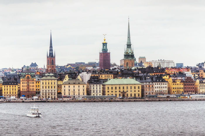 Panoramic view of Gamla Stan (old town) from the sea with floating boat. Stockholm, Sweden Boat Boat Ride Capital Cities  Center Churches Cityscapes Cruise Dusk Europe Famous Place Gamla Stan Harbour View Landmarkbuildings Old Town Panorama Panoramic Photography Port Stockholm Sweden Tranquil Scene Transportation Travel Photography Traveling Twilight Waterfront