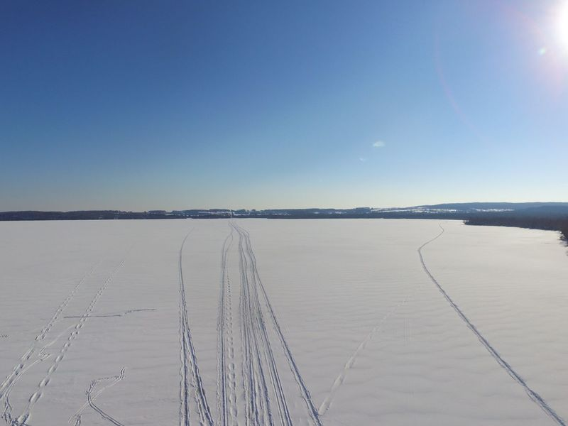 Beauty In Nature Blue Clear Sky Day Lake Ice Landscape Nature No People Outdoors Sky Snow Tracks Tranquility Water