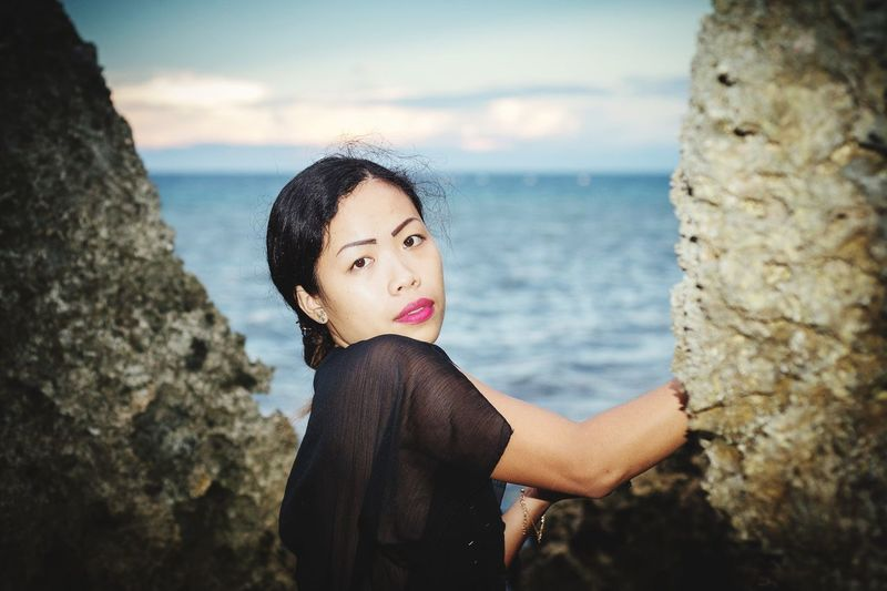 see girl Filipina Philippines Philippinen Black Dress Black Hair EyeEm Selects Water Sea Portrait Blond Hair Beach Wave Standing Women Young Women Rock - Object Cliff Coast Calm