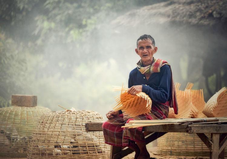 Portrait of man preparing wicker basket