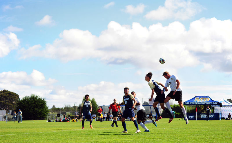 Activity Ball Cloud - Sky Competition Competitive Sport Day Grass Large Group Of People Leisure Activity Lifestyles Men Outdoors Playing Playing Field Real People Sky Soccer Soccer Field Soccer Player Sport Sports Team Sports Uniform Sportsman Team Sport Tree