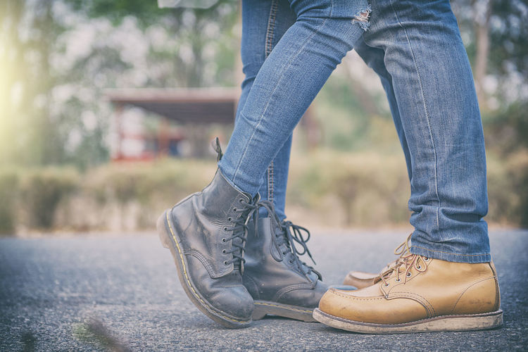 lover Body Part Casual Clothing Day Denim Fashion Focus On Foreground Human Body Part Human Foot Human Leg Human Limb Jeans Lace - Fastener Leather Leisure Activity Lifestyles Low Section One Person Outdoors Real People Relaxation Shoe Standing Textile