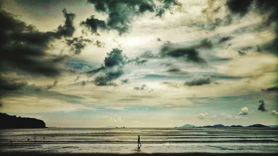 Beach Walk One Person Dawn Hong Kong Vacations Outdoors Discoverhongkong Beach Silhouette Wilderness Natgeo Water Sunset Sea Rural Scene Beach Sky Cloud - Sky Dramatic Sky Atmospheric Mood Moody Sky Cloudscape Romantic Sky Stratosphere