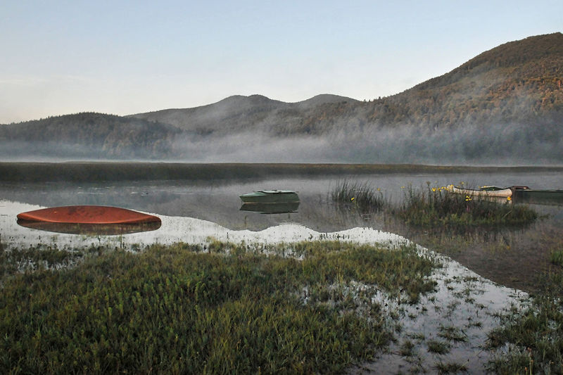 Cerkniško Jezero Red Boat Beauty In Nature Boats Cerknicalake Day Environment Fog Grass Hot Spring Idyllic Lake Land Mountain Nature No People Non-urban Scene Outdoors Plant Scenics - Nature Sinking Boat Sky Tranquil Scene Tranquility Water It's About The Journey