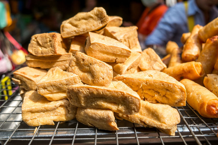 Fried tofu for sale at a local market in bangkok, thailand.