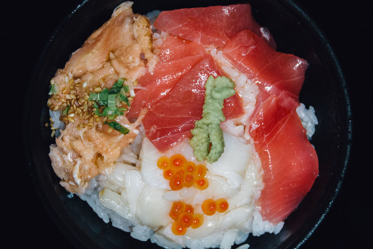 Close-up of fish with rice served in bowl