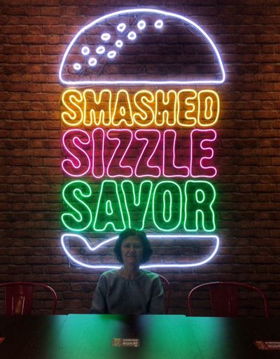 Cafe Text Communication Illuminated One Person Western Script Front View My Best Photo Smiling Real People Neon Glowing Portrait Casual Clothing Green Color Emotion Happiness Sign Women