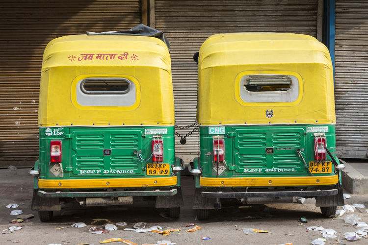 two auto rickshaw parking link together in paharganj, New Delhi, India Auto Rickshaw Day Delhi Indiapictures Land Vehicle Mode Of Transport No People Outdoors Paharganj Parked Public Transportation Rickshaw Taxi Yellow