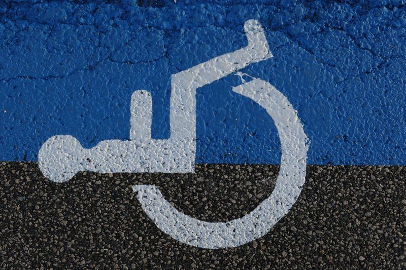Directly above shot of disabled sign on road