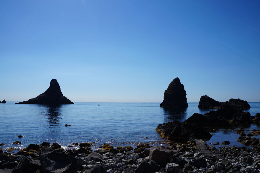 Catania, Sicily Cyclops' Coast Sicily, Italy Sicily's Riviera Dei Ciclopi Beauty In Nature Blue Clear Sky Cliff Day Horizon Over Water Nature No People Outdoors Riviera Dei Ciclopi Rock Rock - Object Rock Formation Scenics Sea Sky Tranquil Scene Tranquility Water