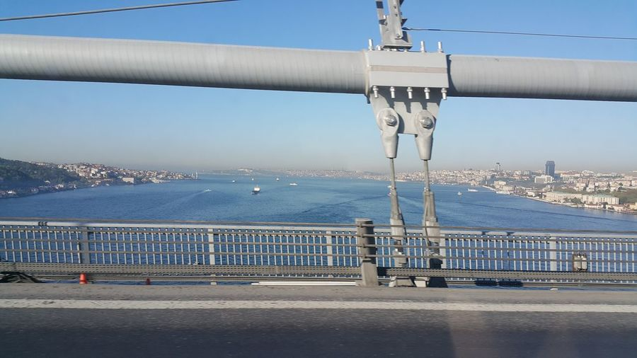 Bosphorus bridge over strait seen through car window