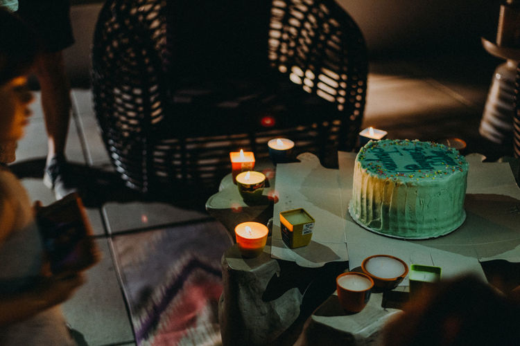 Birthday Party Birthday Cake Candle Intimate Birthday Cake Candle Close-up Container Dessert Food Food And Drink Freshness High Angle View Illuminated Indoors  Indulgence Lighting Equipment No People Selective Focus Still Life Sweet Sweet Food Table Temptation