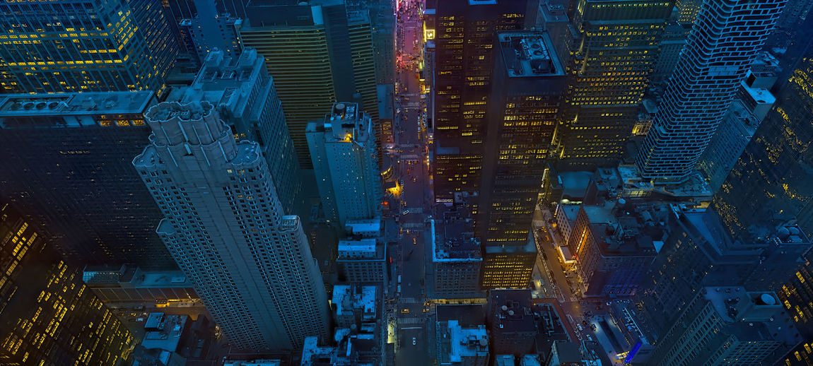 Aerial view of illuminated buildings in city at night,new york city