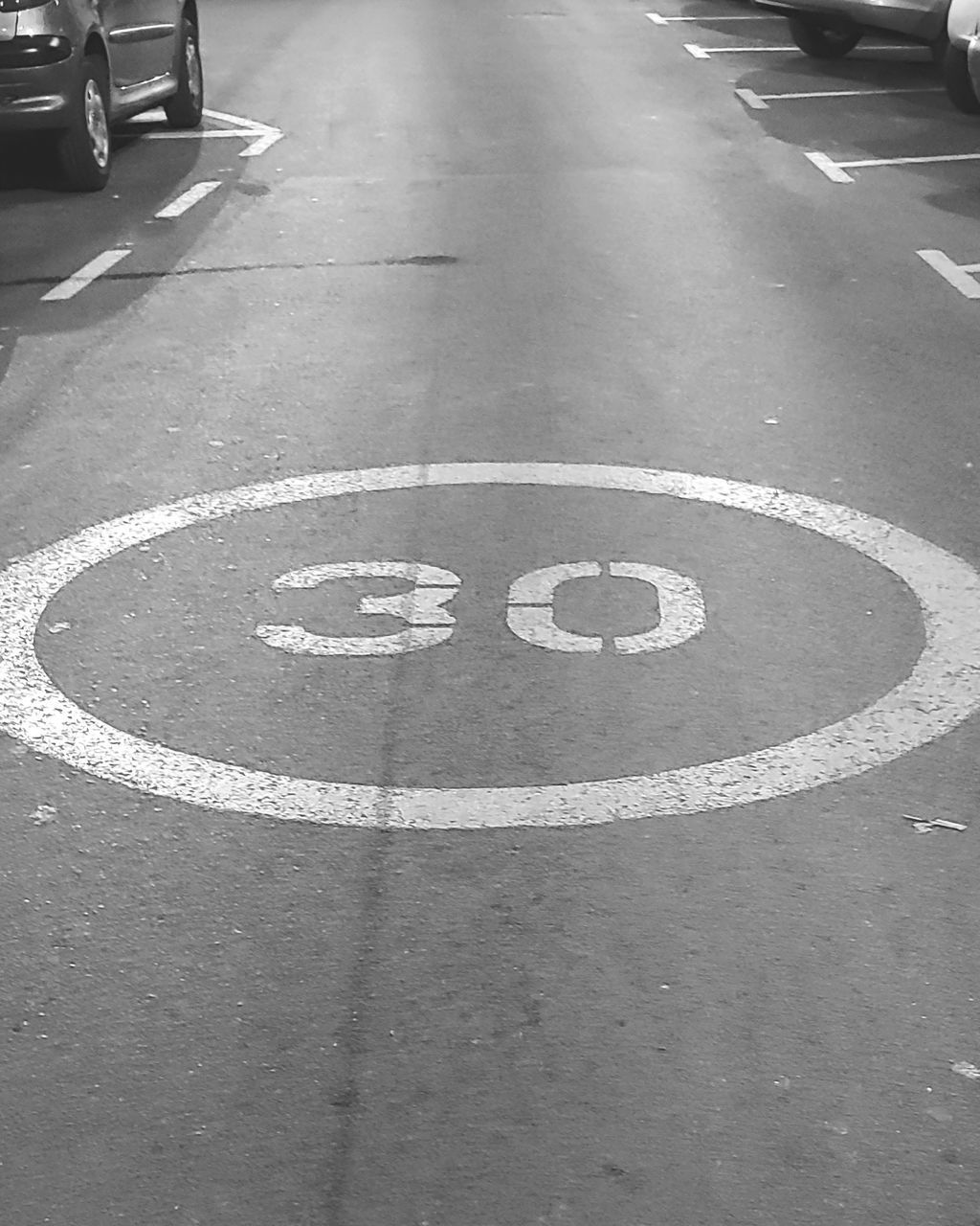 sign, symbol, transportation, communication, road, city, road marking, street, high angle view, marking, no people, day, guidance, land vehicle, mode of transportation, text, outdoors, number, car, safety