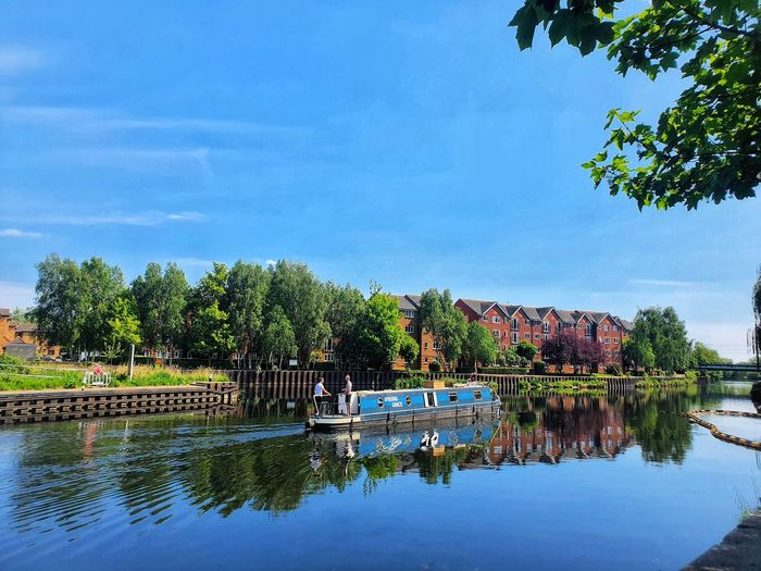 Scenic view of swimming pool by lake against sky