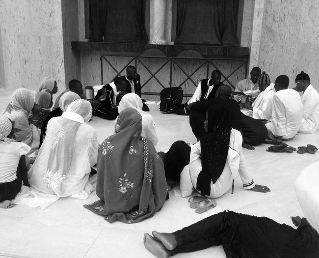 High angle view of people discussing while sitting at mosque