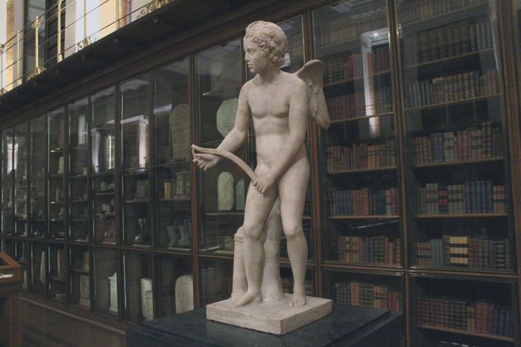 Angel Statue And Books In Museum