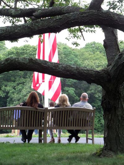 Flag at half mast, Sagamore Hill, Oyster Bay, NY (Presidet Teddy Roosevelt's Summer White House) Half Mast Flag Sagamore Hill Teddy Roosevelt National Park President Oysterbay Park Bench Sitting Sitting Outside People Together