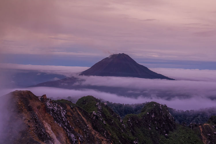 Gunung Sinabung Volcano Cloud Sinabung Sunlight Active Beauty In Nature Cloud - Sky Day Fog Forest Gunung Haze Landscape Mist Mount Mountain Mountain Range Nature No People Outdoors Scenics Sibayak Sky Sunrise Sunset Tranquil Scene Tranquility Volcano