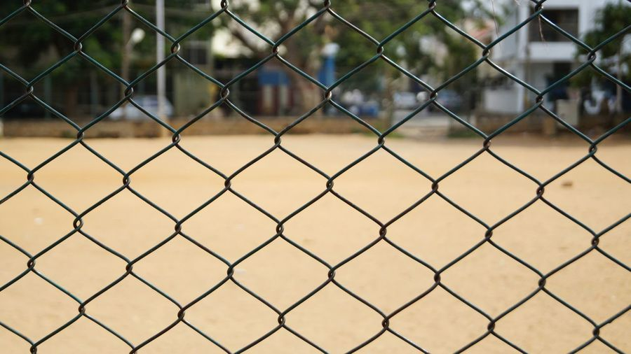 Ground Seen Through Chainlink Fence