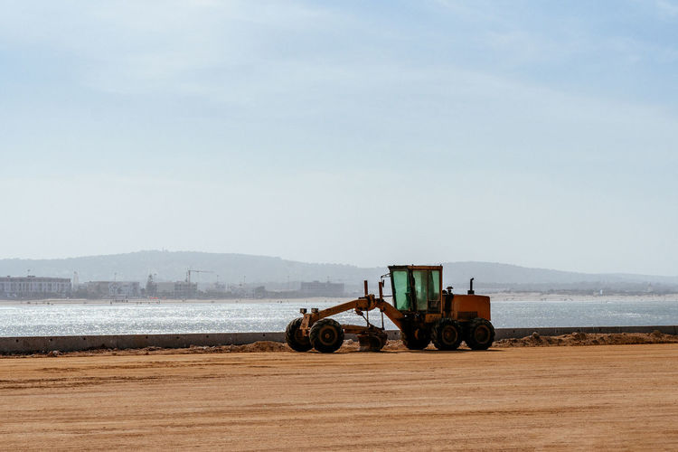 Road grader by the sea, essaouira, morocco.