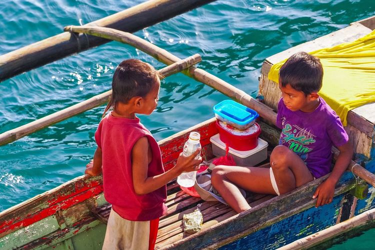 Energy Drink, Children Of Sea Child Boys Childhood Water Happiness People Young Children Batangas Sea Port Life In Colors Sea Real People Happy Journalism Real Life Coin Divers Togetherness EyeEmPhilppines Batangas,philippines EyeemPhilippines Boat Children Young Lifestyles