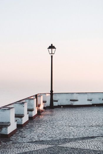 Street Light Clear Sky Sunset Outdoors Sky No People Sea Architecture Built Structure Horizon Over Water Building Exterior Day Nature Scenics Beauty In Nature Water