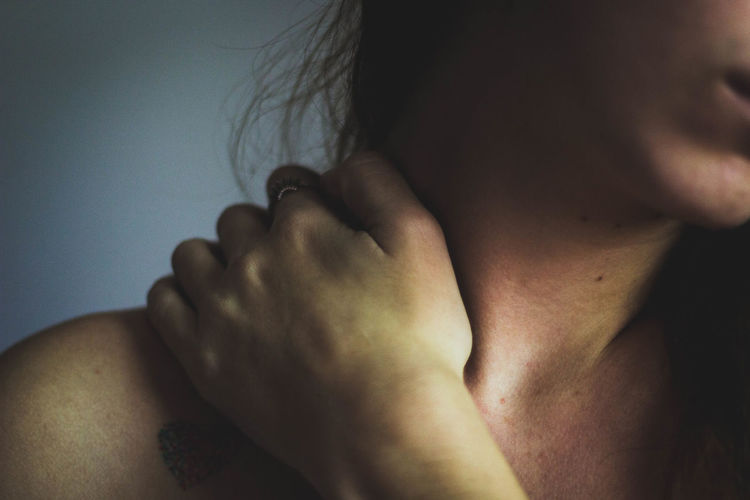 Midsection of woman suffering from neck ache
