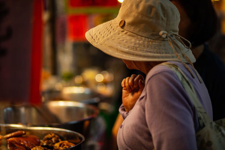 Taipei market Adult Business City Clothing Focus On Foreground Food Food And Drink Hat Holding Incidental People Lifestyles Market Men Occupation One Person Preparation  Preparing Food Real People Selective Focus Unrecognizable Person