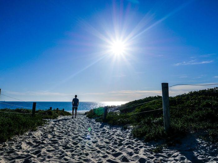 Beach Beauty In Nature Clear Sky Man Remote Standing Sunbeam Sunlight Sunny