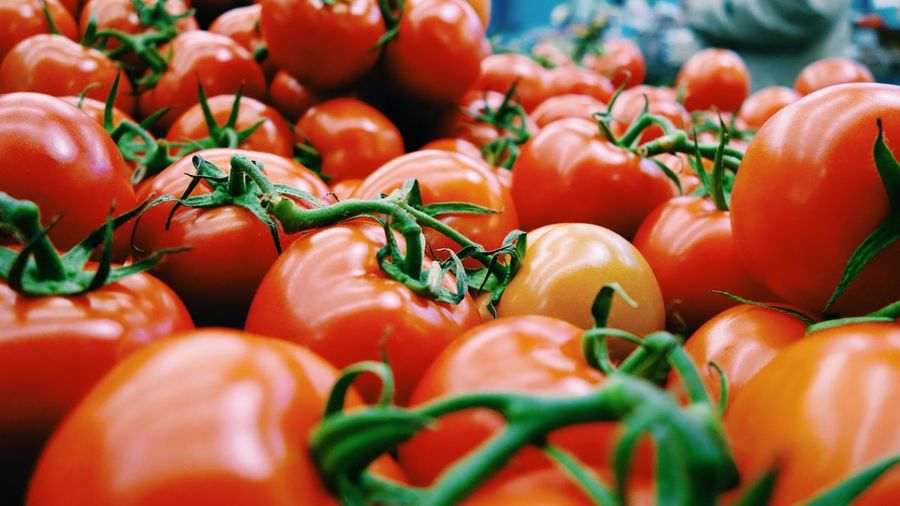 Close-Up Of Tomatoes For Sale At Market Stall