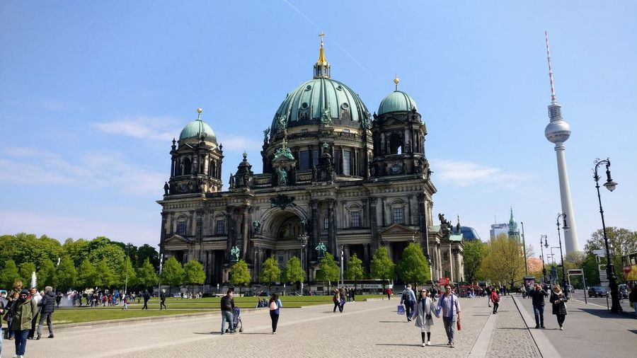 People outside berlin cathedral in city