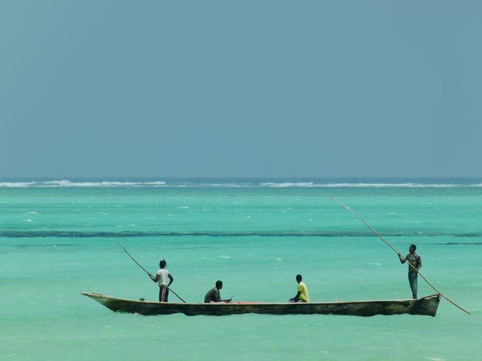 Men On Boat Sailing In Sea