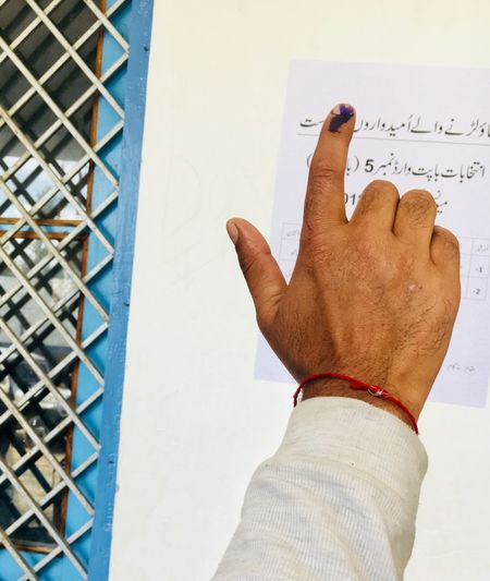 A voter showing inked finger in central Kashmir's Budgam district on Monday. The elections here were held in one ward among 72 for election the Councillor. Only 17 percent turnout was recorded. Elections Polling Station Polling Voting EyeEmNewHere Gettyimages Boycott ULB Men Close-up Finger Human Finger