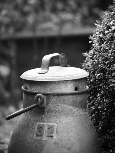 Close-up of milk canister