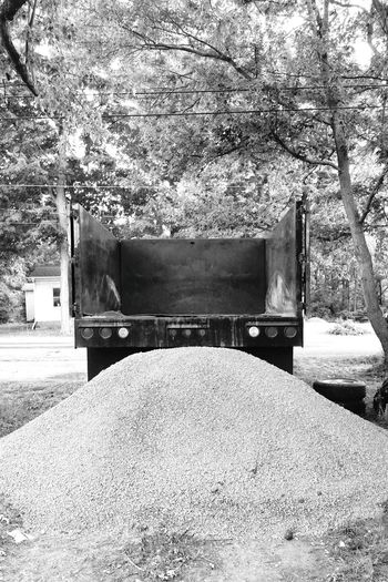 Dump Truck Truck Stone Gravel Construction Hardscape Building Supplies Pile Mound Empty Dumped Unloading Tail Lights View From Behind Monochrome Photography
