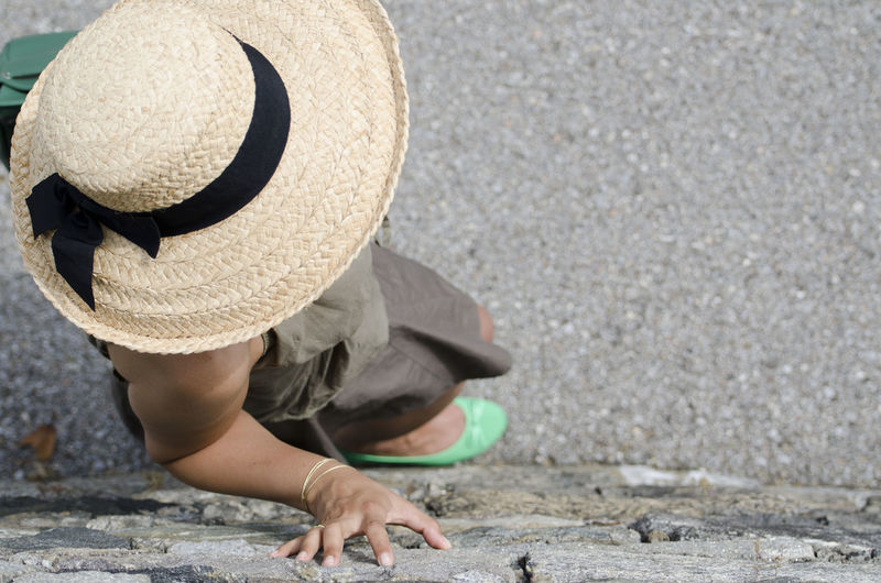 Woman with straw hat leaning on a wall seen from above Above Adult Arm Citylife Copy Space Day Hat Hat High Angle View Human Arm Leaning Lifestyles One Person One Woman Only Outdoors Part Of People Real People Skirt Straw Hat Street Sunny Wall Woman Fresh On Market 2016