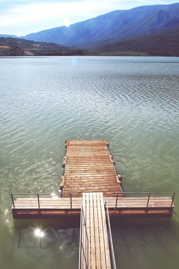 High angle view of pier on lake against sky