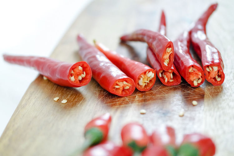 Cayenne Pepper Herbs Herbs And Spices Hot Latin Mexico Spicy Chillies Chillies Red Close-up Cutting Board Food Freshness Healthy Eating Hot Food Ingredient Jalapeños Peppers Red Chillies Red Peppers Spice Spices Table