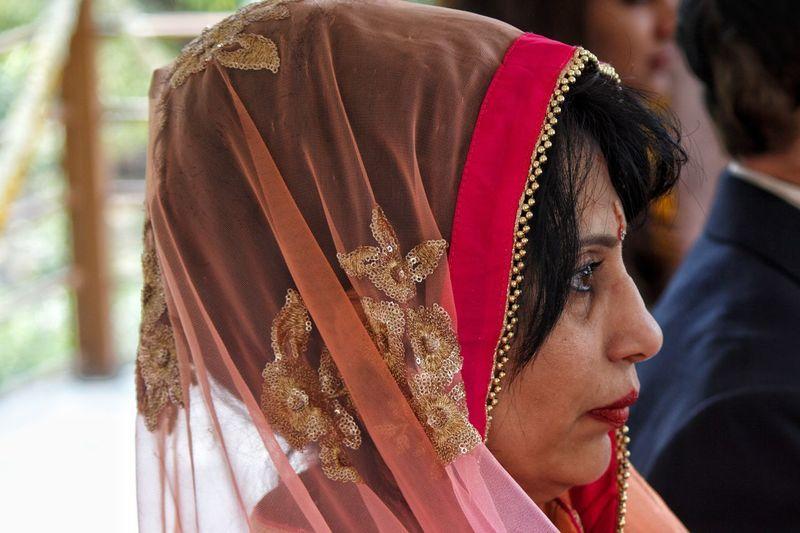 Side view of woman wearing headscarf