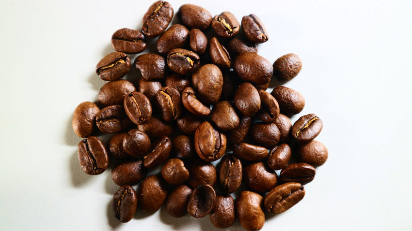 The Coffee Bean Brown Close-up Coffee - Drink Coffee Bean Coffee Cup Food Food And Drink Freshness Group Of Objects Indoors  Large Group Of Objects No People Raw Coffee Bean Roasted Roasted Coffee Bean Scented Still Life Studio Shot White Background