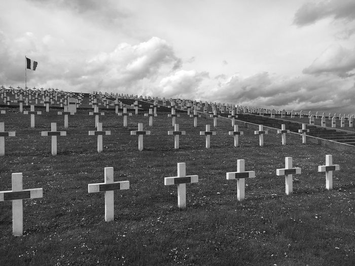 Crosses On Field Against Sky At Cemetery