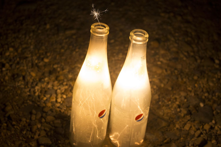 // Sparks 💫✨ Drinking Glass Glowing Celebration Bottle Shiny Close-up Black Background Gold Colored No People Frosted Glass Drink Fragility Sparklers EyeEmNewHere Nightphotography Light Painting Long Exposure Live For The Story