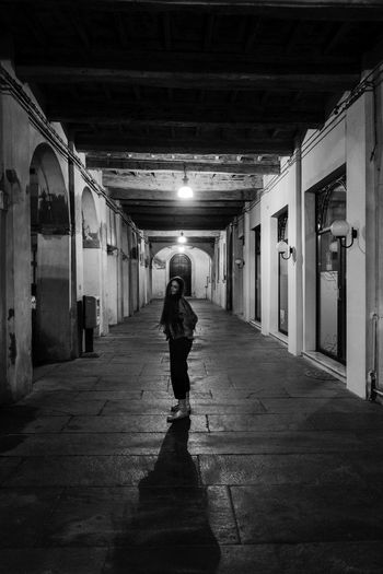 Beautiful Arcade Architecture Blackandwhite Building Built Structure Ceiling Diminishing Perspective Direction Full Length Gallery Illuminated Indoors  Leisure Activity Lifestyles Lighting Equipment One Person Portrait Readhead Real People Rear View The Way Forward Transportation Walking #urbanana: The Urban Playground