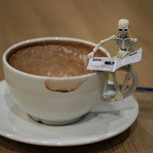 Skeleton Toy Concept Fun Newpaper Read Halloween Festival Cute Horror Table Wood Business Vecation Object Relax Abstract Happy Holiday Day Close-up Close-up Food And Drink Beverage Coffee Cappuccino Black Coffee Latte Froth Coffee Cup