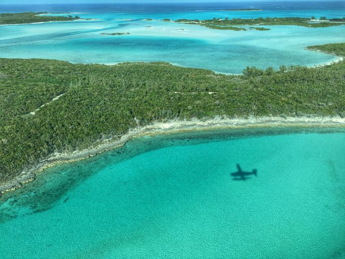 Aerial View Of Plane Shadow In Sea At Exuma
