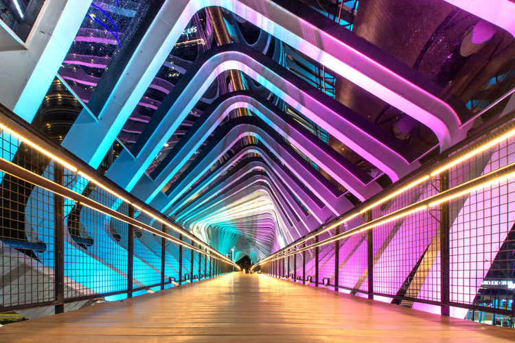Illuminated footbridge at night